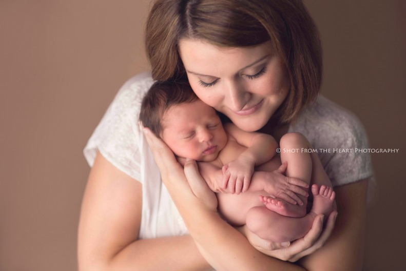 Atlanta newborn photography. Baby E in mom's arms. They're only this tiny for a very short time.